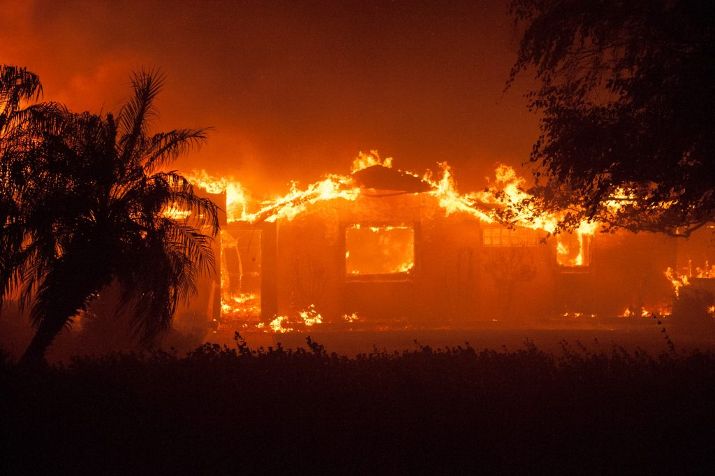 A house burns on Oakridge Drive near Paradise burns on Thursday Night.