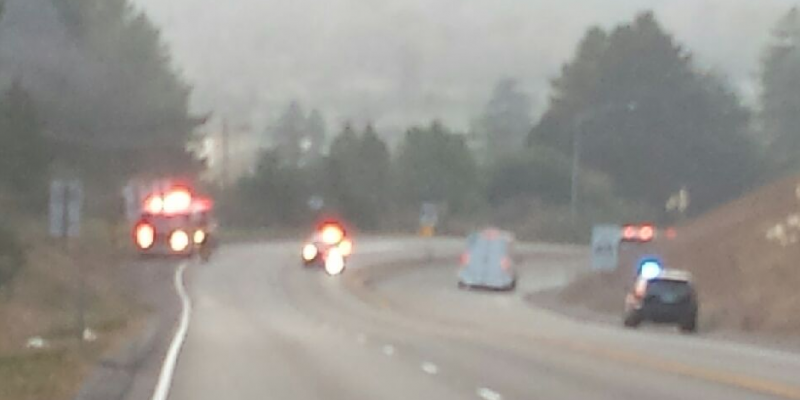 Fire engines and law enforcement along Hwy 299 at a fire that is now under control.