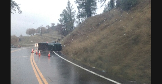 Overturned pickup is blocking the southbound lane.