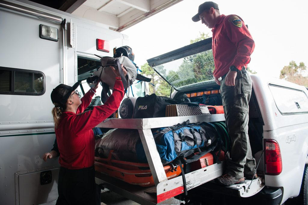 Kate Witthaus and Logan Mitchell load gear into their search vehicle at the Humboldt County Sheriff's Office Boat Yard.
