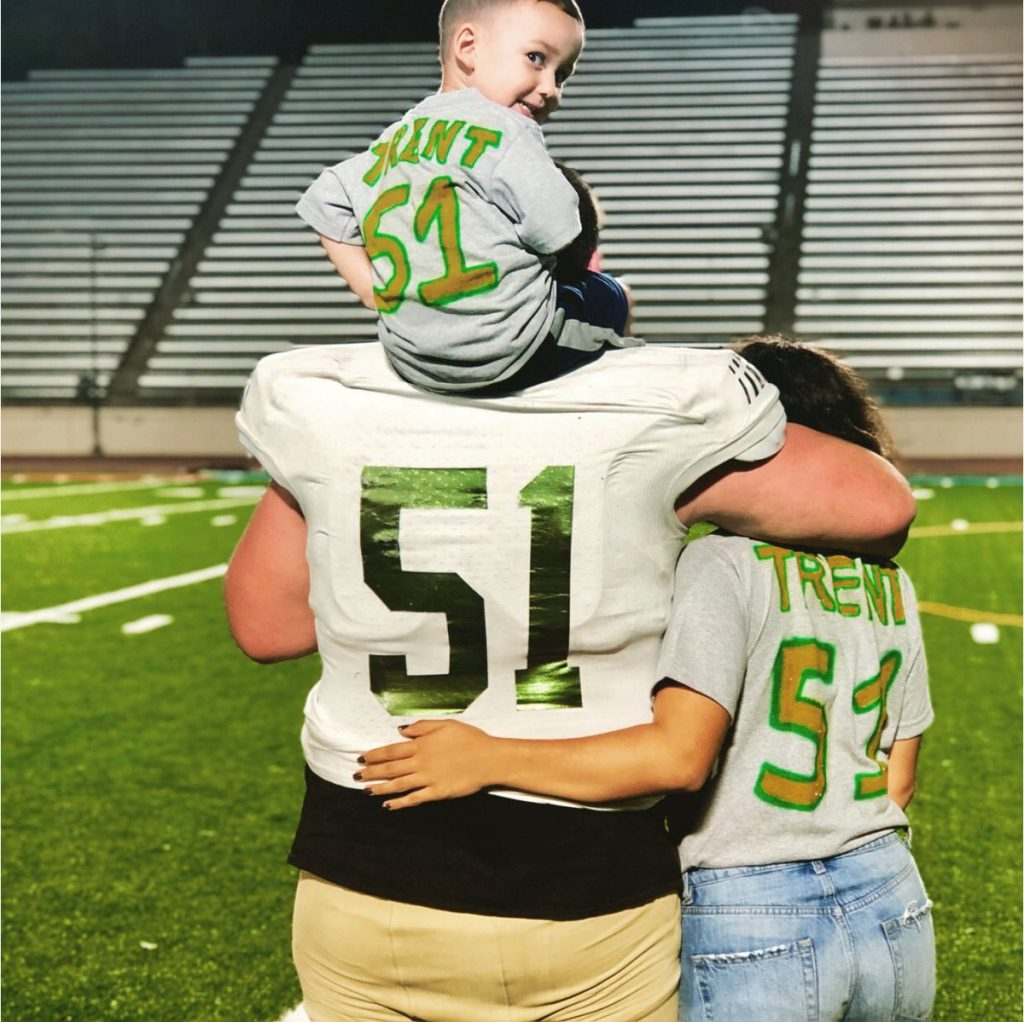 Nathan Trent, the Lumberjacks number 51 with Sabrina Jaquez and their son.