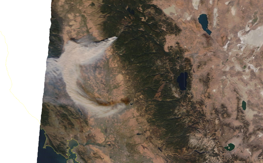 Satellite Image taken at 3:12 p.m. The blue lake in the center with the white line through it is Lake Tahoe with California's border overlayed in white.