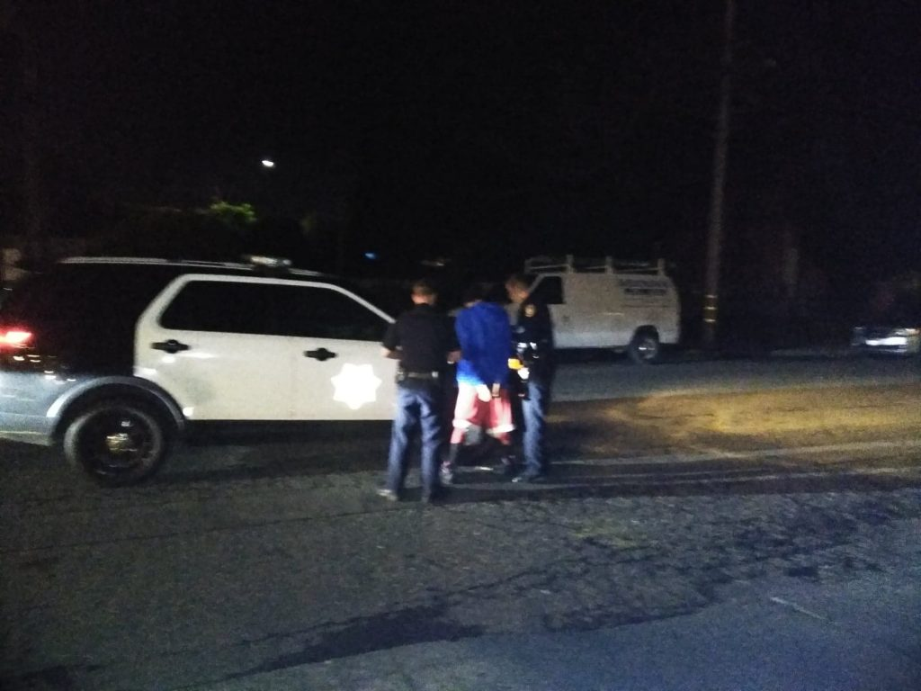 The suspect is handcuffed. EPD