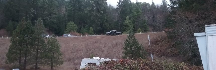 Law enforcement and the victim's vehicle on Hwy 36.