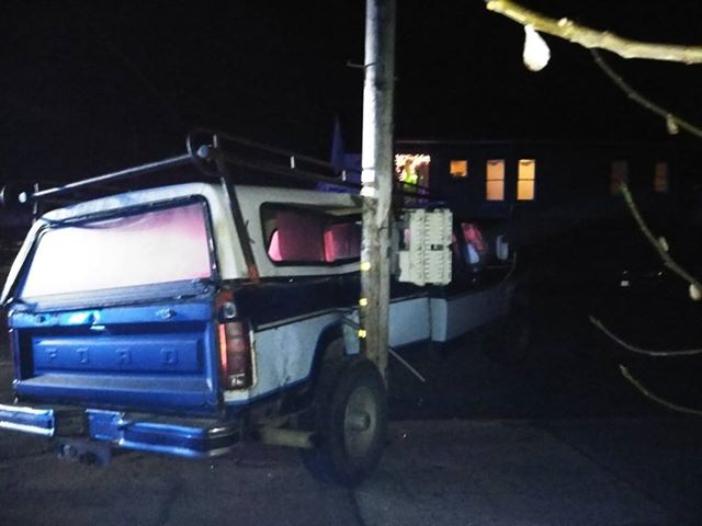Pickup stuck on a telephone pole after the accident tonight.