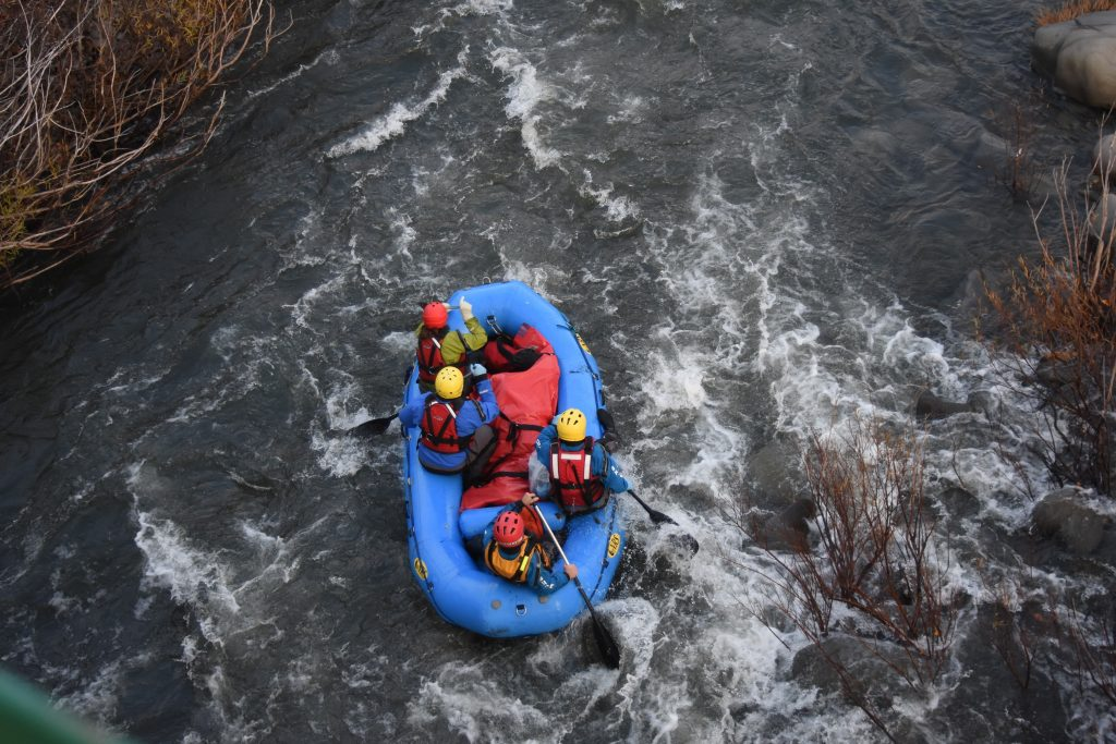 Four members of Southern Humboldt County Technical Rescue guiding the body found earlier in the day through rapids