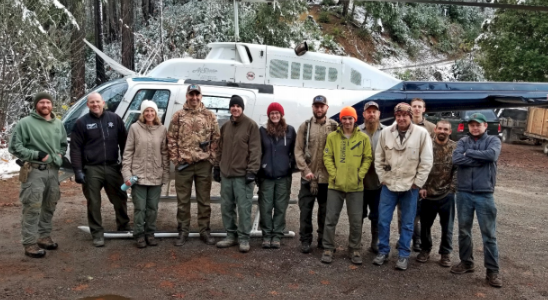 A delighted team following a successful reclamation operation on National Forest Lands.