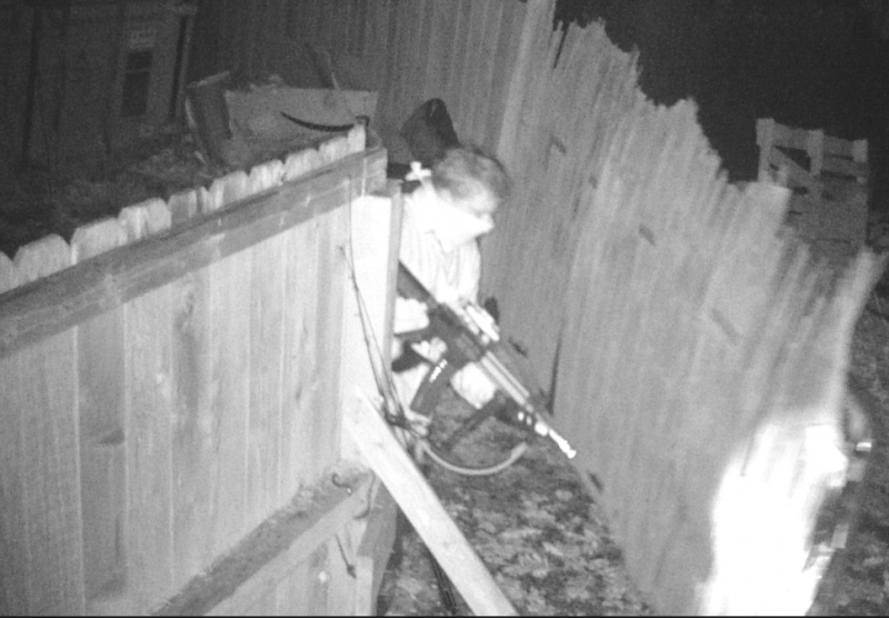 One burglar was holding what appeared to be a large firearm.