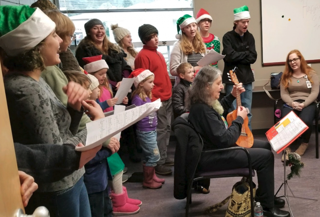 The 4-H members and their families singing. [Photo by Robert LeClair]