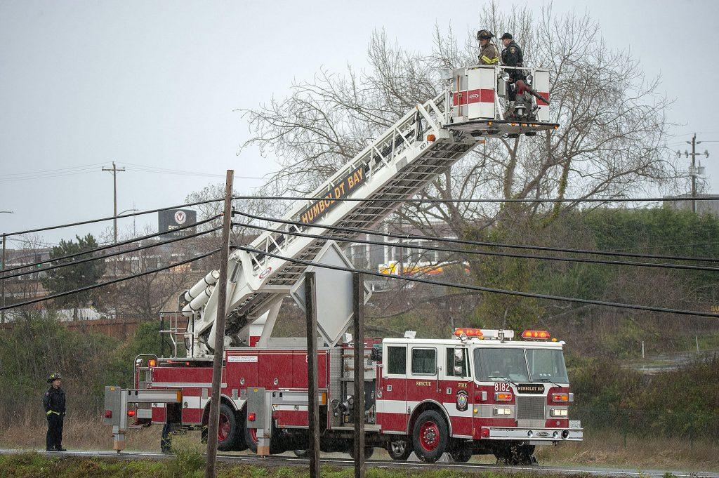 A ladder fire truck provides a platform for photos.