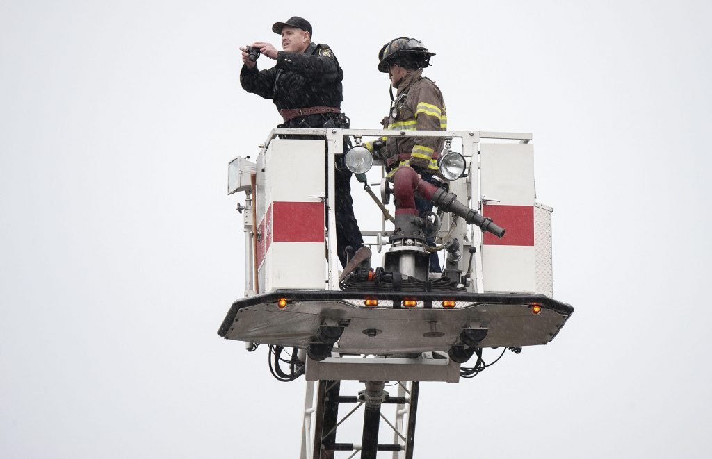 Officer and firefighter in ladder truck