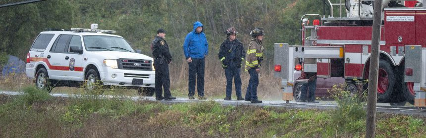 Death investigation continues even though the rain keeps falling hard.
