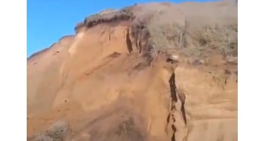 screen shot of centerville beach bluff collapse