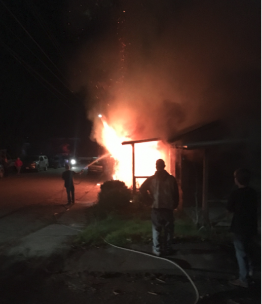 Neighbors trying to keep the fire from spreading.
