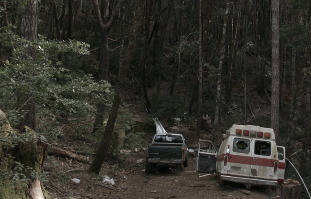"""Screenshot from Episode 4 of """"Murder Mountain"""" shows the cabin on a piece of property with a large amount of trash. Many viewers assume that the property is on """"Murder Mountain"""" but the actual property is located about a 45 minute drive west of there."""