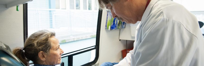 Duane Kyle prepares to draw blood from Melissa Martel, who works for Environmental Health, on the bloodmobile in Old Town Thursday.