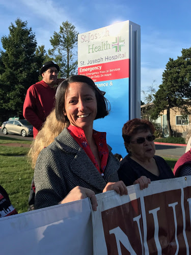 Eureka First Ward City Council member Leslie Castellano joins in the protest.
