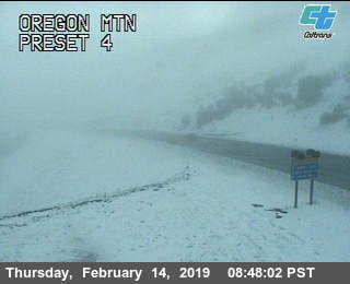 Snow on Oregon mountain[Image from Caltrans. To see the latest image,click here.]