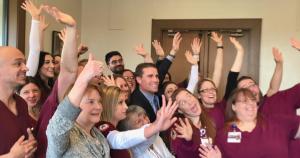 Senator Mike McGuire surrounded by St. Joe's nurses.