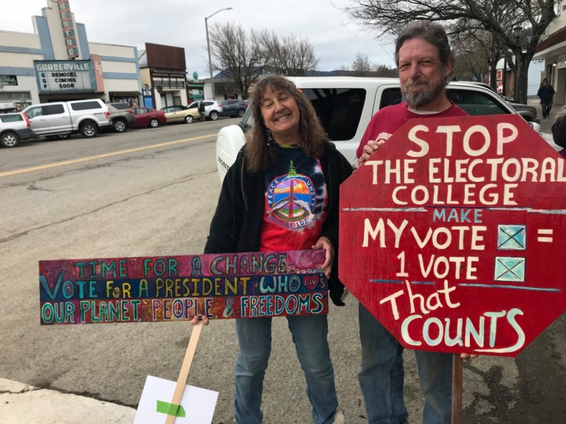 Layne Murrish and her husband, Don with their signs.