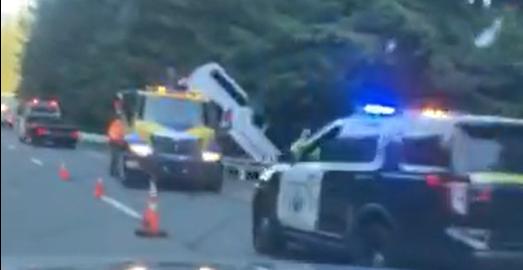 Vehicle jackknifed over guardrail
