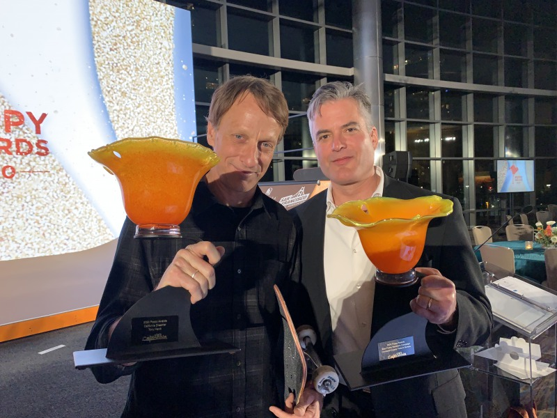 poppy.award.hawk.stenger.jpg Skateboard legend Tony Hawk, left, and Humboldt CVB media specialist Richard Stenger. Photo by Bob Gilbert.