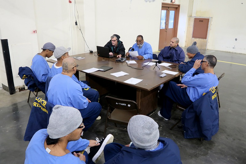 Pelican Bay State Prison A-yard students in Paul Critz's audio journalism class work on producing a podcast episode of Pelican Bay: UNLOCKED in winter 2019. Photo courtesy of Paul Critz.