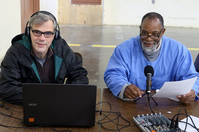 Audio journalism teacher Paul Critz and incarcerated student Barry Woods recording an episode for Pelican Bay State Prison's podcast Pelican Bay: UNLOCKED. Photo Courtesy of Paul Critz.