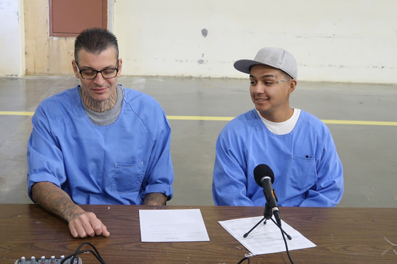 Incarcerated A-yard students Daniel Noriega and Marco Garcia Jr. brainstorming ideas for a new podcast episode. Photo courtesy of Paul Critz.