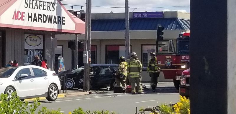 Car into utility pole