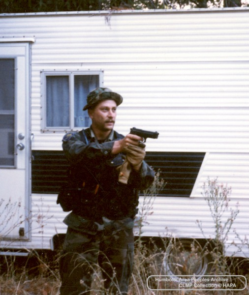 CAMP officer photographed by Garberville-based Citizens Observation Group volunteer in 1985 Southern Humboldt raid, image part of the Civil Liberties Monitoring Project collection at HAPA.