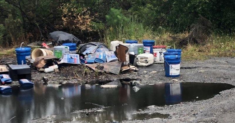Trash including spilled oil east of the Alderpoint Bridge.