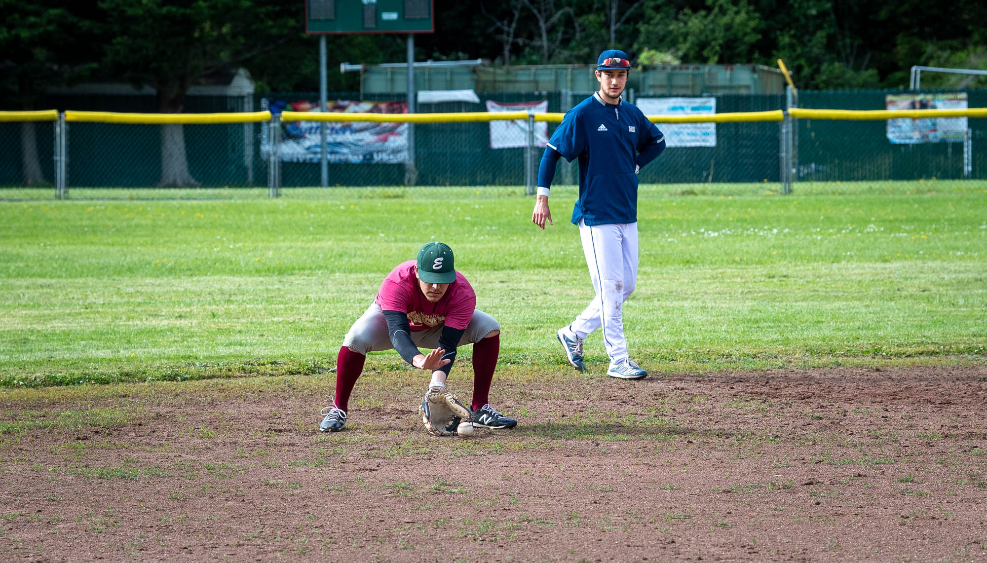 An Eagles hopeful fields a grounder during assessments at Redwood Fields.