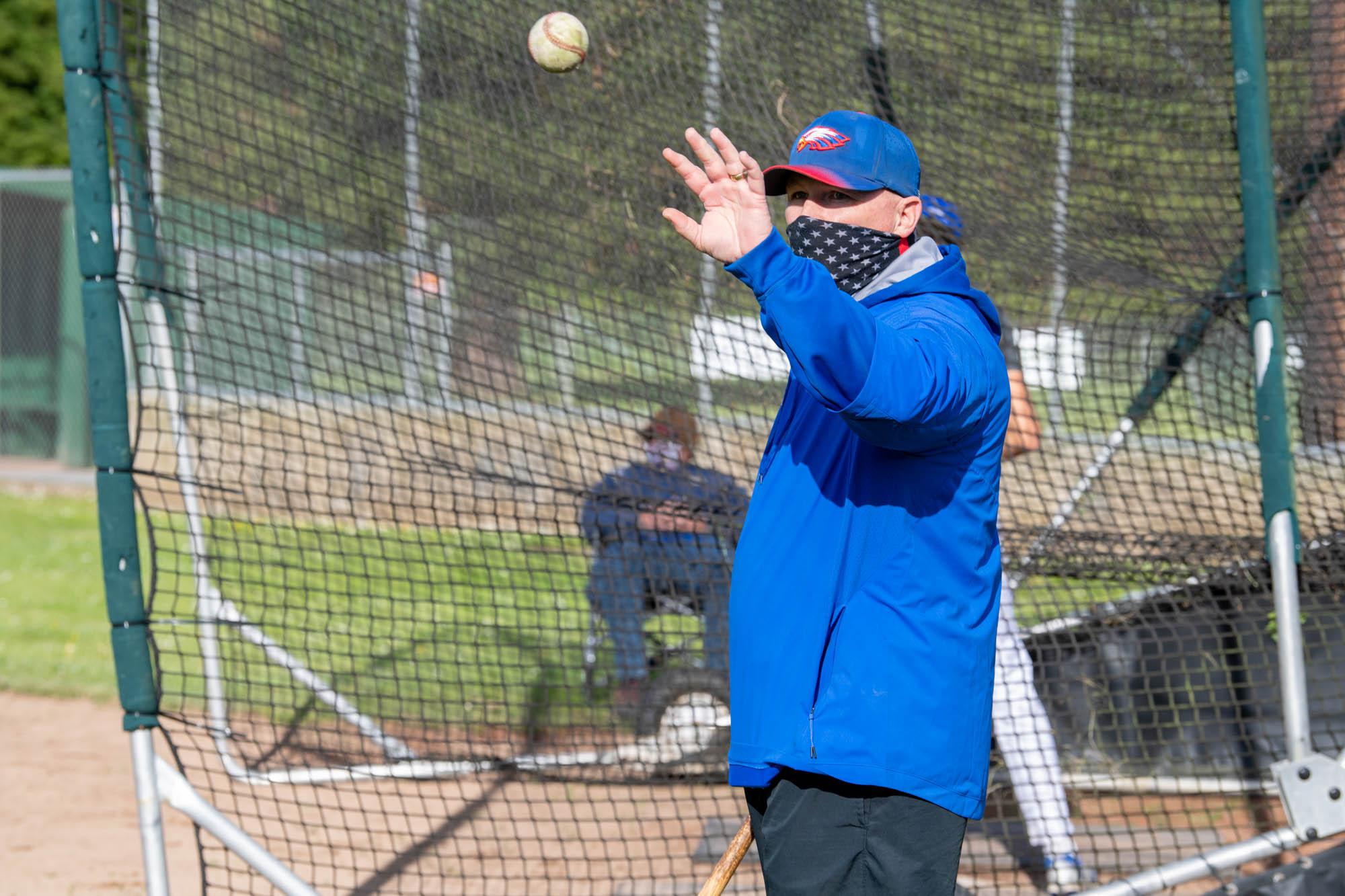 Coach Dan Joyner catches an incoming ball.