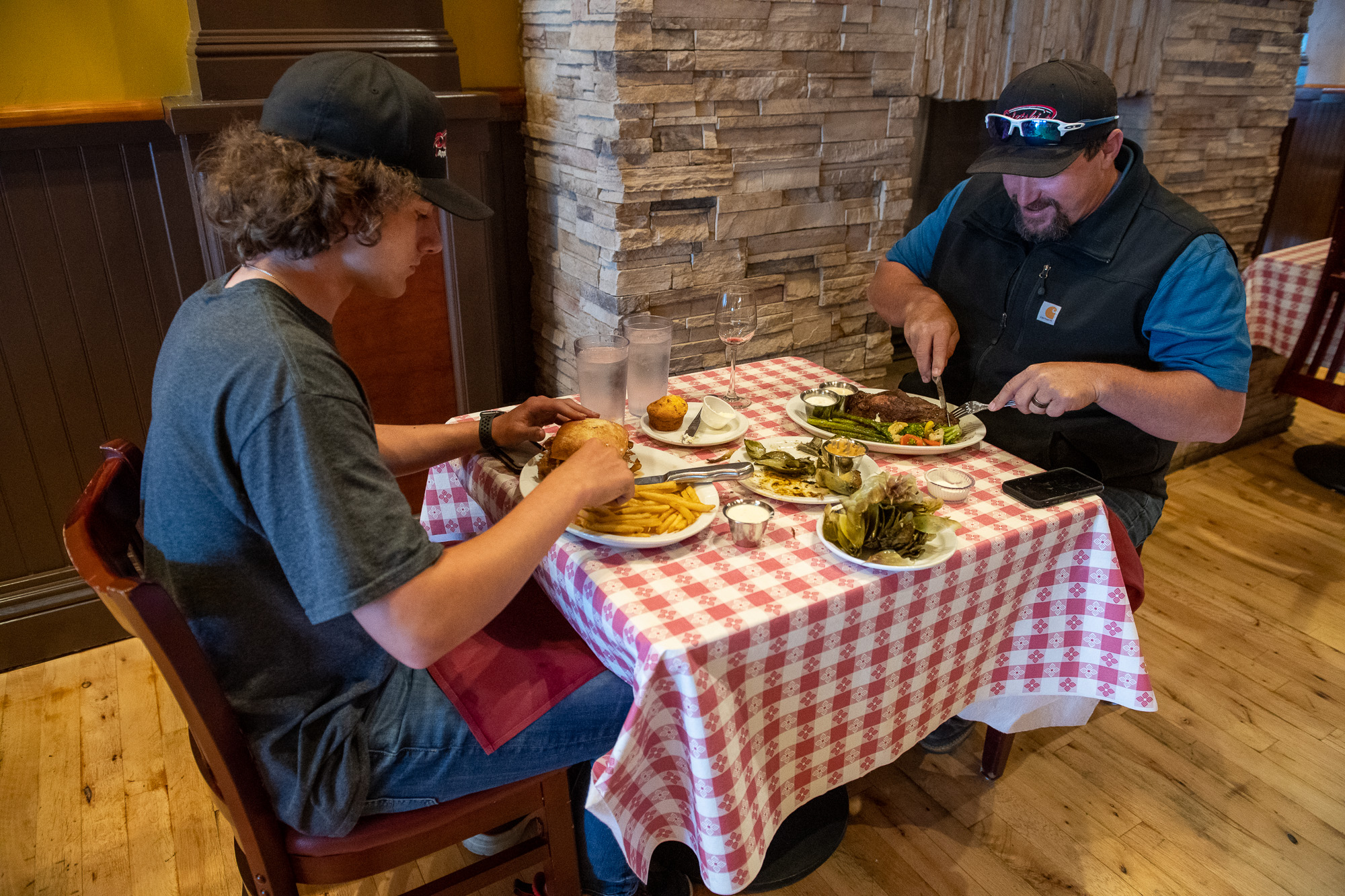 Rick Poletski and his son Tyler talk with Shamus T Bones owner Chris Barry on the first night of dine in service in Humboldt County since the shelter in place orders were given.
