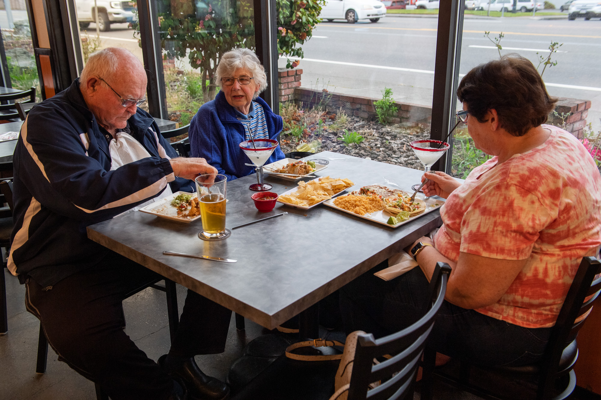 From left to right: Richard Cahill and Pat Cahill, of Ferndale, and Denise Cahill, who was visiting from Visalia, enjoy food at Tres Picosos on the first night of dinner service after easing of the shelter in place orders.