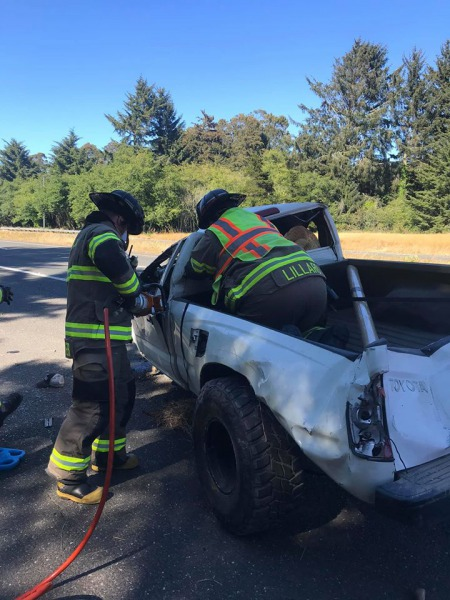 Emergency personnel use the Jaws of Life to extract the driver from this badly damaged pickup. [All Photos from the Arcata Fire District]
