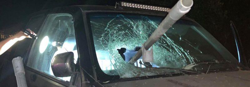 Fence pole impaling pickup windshield