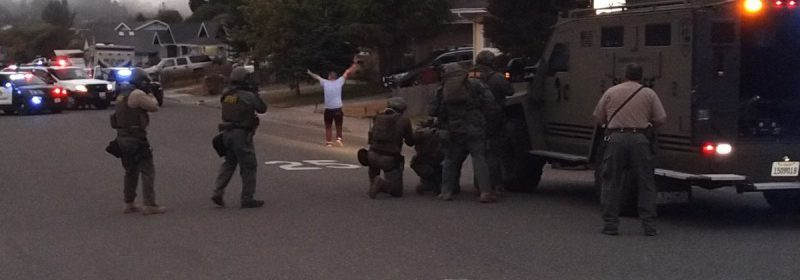 Suspect surrendering. [Crop of a photo by the HCSO]