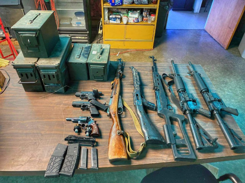 Mendocino County Sheriff Office's photograph of the firearms confiscated at today's raid in Round Valley [Photo provided by Mendocino County Sheriff Matt Kendall]