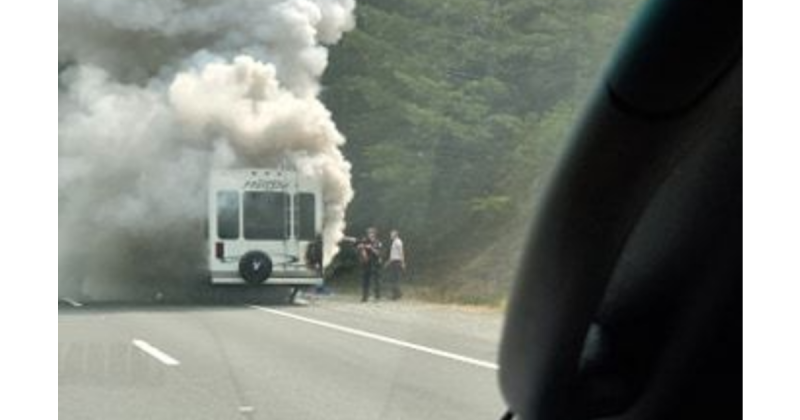 Smoke boiling from the vehicle.