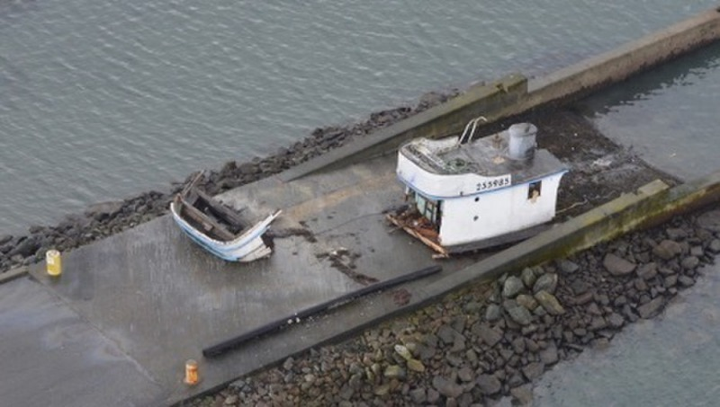The commercial crab fishing vessel SUNUP sunk in the entrance channel Humboldt Bay, Calif., January 24, 2021. The Coast Guard rescued the three people aboard the SUNUP after the vessel lost propulsion and collided with the jetties while attempting to transit through the entrance channel. (U. S. Coast Guard courtesy photo)