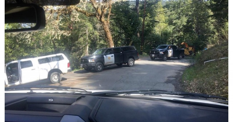Law enforcement arriving at the residence in the Salmon Creek watershed today.