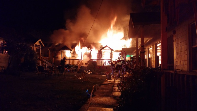 Flames poured from the building on Pine Street during the early morning hours. [Photos from Redway Fire Chief Brian Anderson]