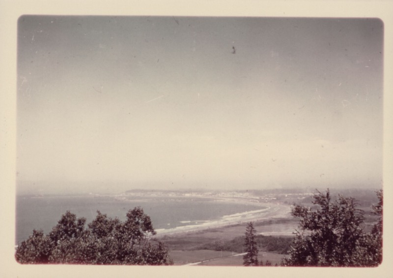 View from afar of Crescent City and coastline [Photo courtesy of HSU Library Humboldt Room Photograph Collections, HCC Photos]
