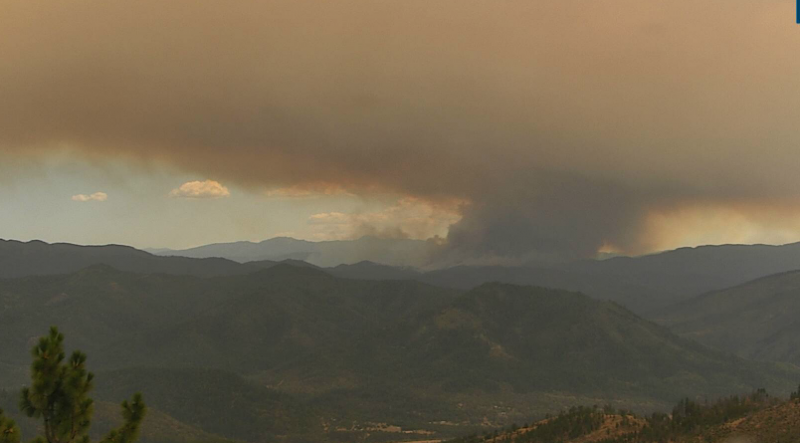 Thick dark column of smoke rising from the McFarland Fire about 3:45 p.m.