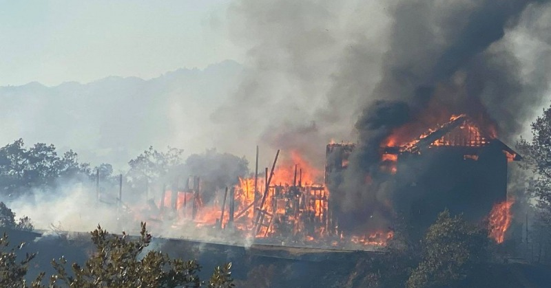 A house burns down in the Black Oak Estates as the Hopkins fire continues to spread. [Photo by Matt LaFever]