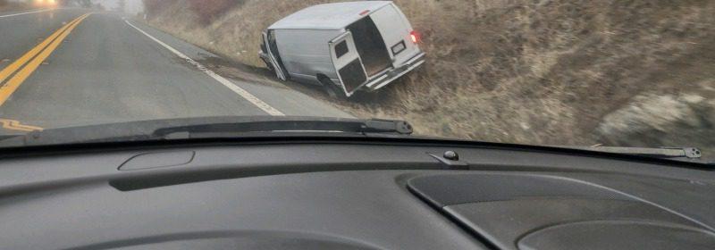 White van abandoned after crash